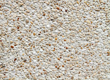 Gravel stone wall texture and background Stock Photos