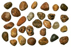 Gravel Stones. Varicolored granite and quartz round gravel stones. Isolated objects on a white background Royalty Free Stock Photos