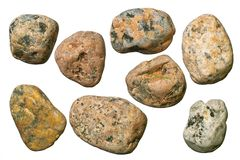 Gravel stones. Varicolored granite and quartz round gravel stones. Isolated objects on a white background Stock Photography