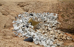 Gravel Stones Around Overflow Drain Royalty Free Stock Image