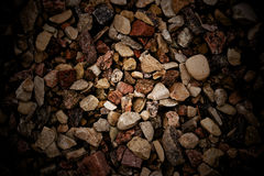 Gravel. Stones background, spot lighting in the middle Stock Images