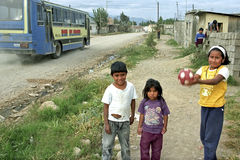 On gravel street playing Native American Children Royalty Free Stock Image