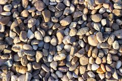 Gravel surface, gravel background, stones texture. Gravel surface, beige gravel background, stones texture Royalty Free Stock Images