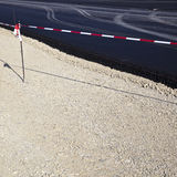 Gravel surface on new road Stock Image