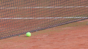 Gravel tennis court with tennis ball Royalty Free Stock Photography