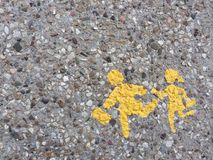 Gravel texture pebble floor painted yellow background of children crossing stock photography