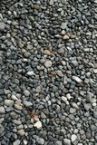 Gravel texture. Small stones, little rocks, pebbles in many shades of grey, white and blue. Texture of little rocks, background.  royalty free stock image