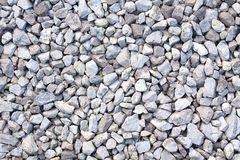 Gravel texture. Small stones, little rocks, pebbles in many shades of grey, white and blue. Texture of little rocks. Gravel texture. Small stones, little rocks stock photo