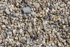Gravel texture. Small stones, little rocks, pebbles in many shades of grey, white, brown, green and blue. stock photos