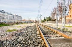 Gravel urban crossing railroad Stock Photo