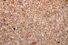 Gravel wall texture Stock Images