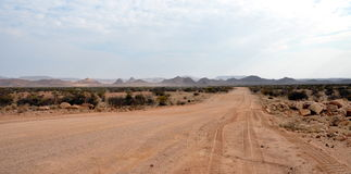 Graveld road in Namibia Stock Images