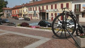 Gravellona, Italy - circa May 2016: Bike statue in front of the town hall stock video footage