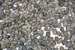 Gravels on white cement. Floor Stock Image