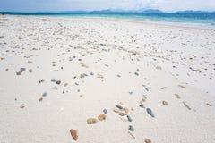 Gravels on white sand beach. Light blue sky background. Summer t. Ime. Khang Khao Island, Laem Son National Park. Ranong Province. Thailand Stock Photo