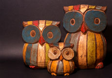 Graven owl family. Vintage painted Graven owl family stock photography