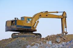 Gravende machine stock afbeelding