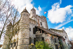 Gravensteen castle in Ghent, Belgium. Gravensteen castle or Castle of the Counts in Ghent, Belgium against cloudy blue sky stock photos