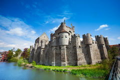 Gravensteen castle in Ghent, Belgium, Europe. Gravensteen castle in Ghent, Flemish region of Belgium during daytime in summer view with river from the bridge Royalty Free Stock Photos