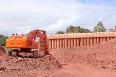 Graver op een bouwwerf Stock Foto