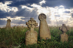 Graves. Ancient tombstones in an old cemetery royalty free stock images
