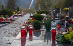 Graves. Grave candles are lit on a cemetery in the town of Celje, Slovenia. Lighting grave candles on Reformation Day (31 October) and All Saints (1 November) is Royalty Free Stock Photos