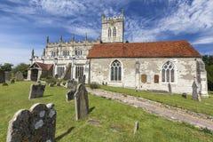 Graves around Saxon Sanctuary. Grave Stones around the Saxon Sanctuary Church in Wootton Wawen, England royalty free stock photo