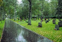 Graves on a cemetery in Solna. Stockholm on a rainy day royalty free stock images
