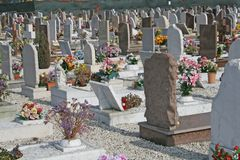 Graves headstones and crucifixes of a cemetery royalty free stock photos