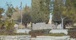 Graves in a military cemetery in Israel. Tracking shot of Graves in a military cemetery in Israel stock footage