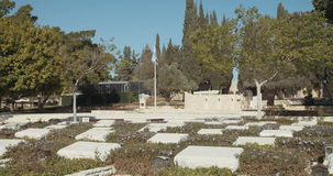 Graves in a military cemetery in Israel. Tracking shot of Graves in a military cemetery in Israel stock video