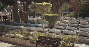 Graves in a military cemetery in Israel. Tracking shot of Graves in a military cemetery in Israel stock video footage