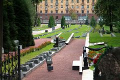 Graves and modern building in Grodno, Belarus Stock Photos