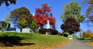 Graves of Notre-Dame-des-Neiges Cemetery. MONTREAL CANADA OCTOBER 11 2015: Graves of Notre-Dame-des-Neiges Cemetery with colorful autumn trees. Is the largest stock image