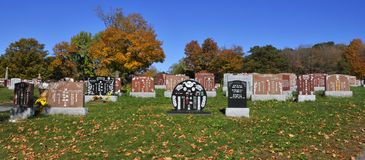 Graves of Notre-Dame-des-Neiges Cemetery. MONTREAL CANADA OCTOBER 11 2015: Graves of Notre-Dame-des-Neiges Cemetery with colorful autumn trees. Is the largest stock photo