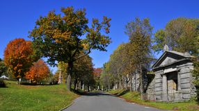 Graves of Notre-Dame-des-Neiges Cemetery. MONTREAL CANADA OCTOBER 11 2015: Graves of Notre-Dame-des-Neiges Cemetery with colorful autumn trees. Is the largest stock images