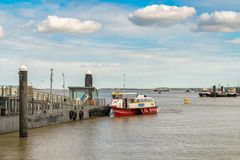 Gravesend, Kent, England, UK. September 23, 2017: View at the River Thames and the Town Pier Ferry Terminal, with people in the ferry boat arriving from stock image