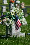 Gravesite. With flag others out of focus Royalty Free Stock Images