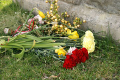 Gravesite Memorial Flowers. A bouqet of fresh flowers lay in respect at the foot of this gravestone Stock Images