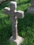 Gravestone. An old stone tombstone in a grassy cemetery Stock Photography