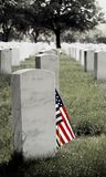 Gravestone and American Flag Royalty Free Stock Photos