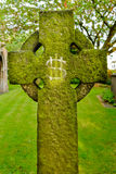 A gravestone bearing an IHS Christogram monogram Royalty Free Stock Photography