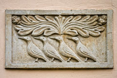 Gravestone with birds. bas-relief Royalty Free Stock Image