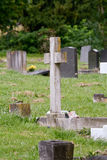 Gravestone cross. And graves in cemetery Royalty Free Stock Photography