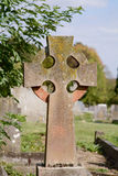 Gravestone cross. Stained by red and yellow lichen Royalty Free Stock Image