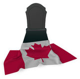 Gravestone and flag of canada Stock Images