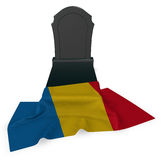 Gravestone and flag of romania Stock Photos