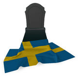 Gravestone and flag of sweden Stock Photos