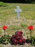 Gravestone: floating white cross. Floating white cross - temporary grave marker Stock Photography