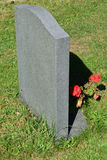 Gravestone with flowers. Plain marble Gravestone with flowers Royalty Free Stock Images